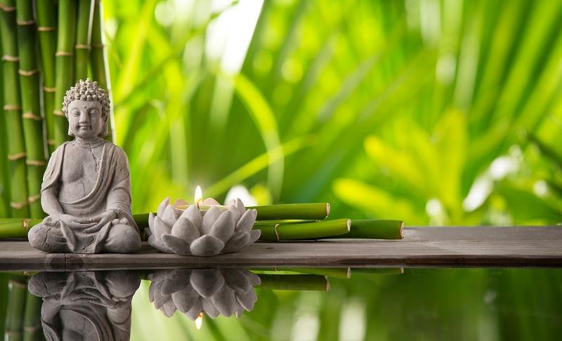 Buddha,In,Meditation,With,Burning,Candle